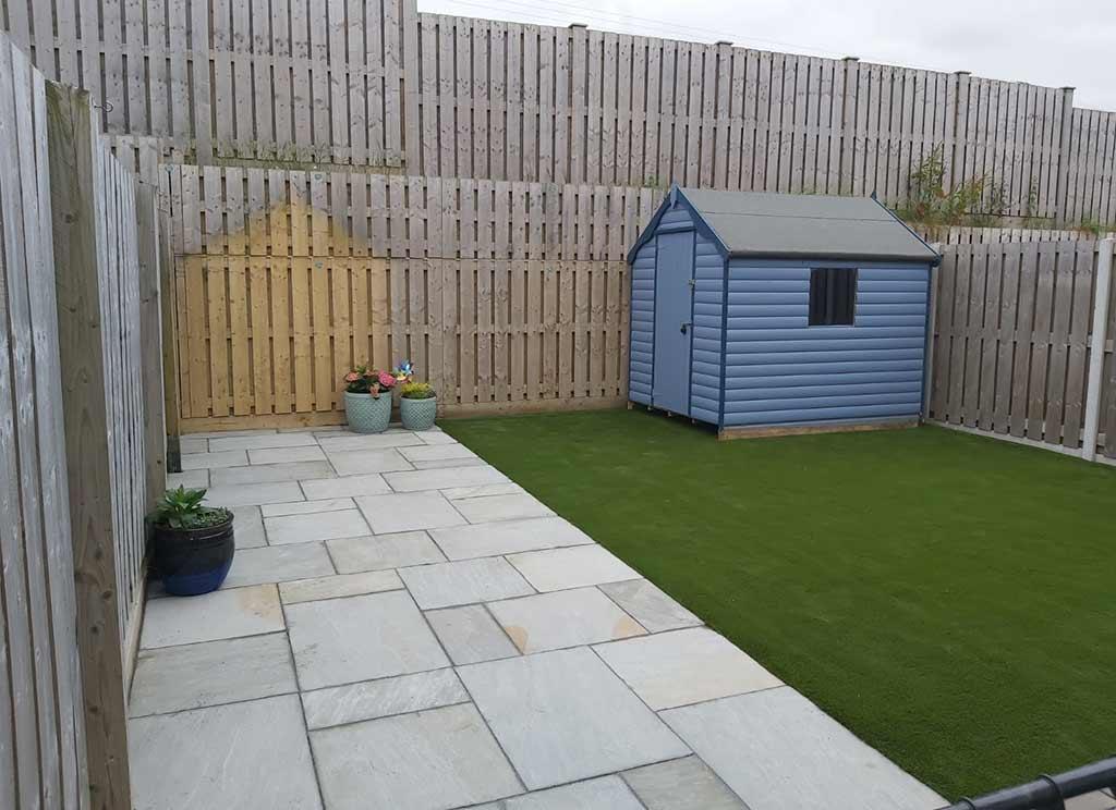 Artifical Grass & Grey Sandstone Paving Dublin Garden